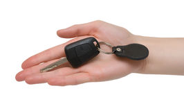 Car key in hand. Car key in female hand. Isolated over white Stock Images