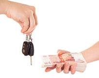 Car key in hand and cash money Stock Photography