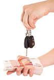 Car key in hand and cash money Stock Images