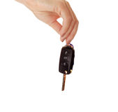 Car key in hand isolated on white background Royalty Free Stock Photography