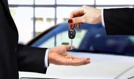 Car key handover at showroom Stock Photo