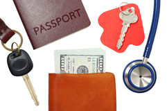 Car key, house key, passport and stethoscope with money in wallet Stock Photo