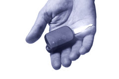 Car key on human hand Stock Images