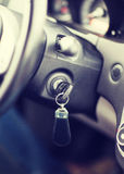Car key in ignition start lock. Transportation and ownership concept - car key in ignition start lock stock image