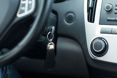 Car key in ignition start lock. Transportation and ownership concept - car key in ignition start lock Stock Photo
