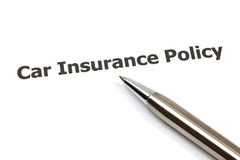 Car key on an insurance policy. With pen on white Royalty Free Stock Photo