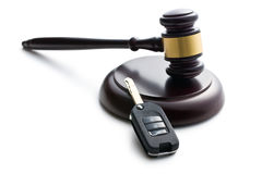 Car key and judge gavel. On white background Royalty Free Stock Photography
