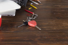 Car key, laptop computer and notebook on office desk Royalty Free Stock Photos