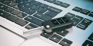 Car key on a laptop. 3d illustration. Car key on a computer keaboard. 3d illustration Royalty Free Stock Image