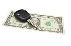 The car key lies on a dollar denomination Royalty Free Stock Image