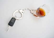 Car key locked to glass of alcohol Royalty Free Stock Photos