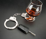 Car key locked to glass of alcohol Stock Photos