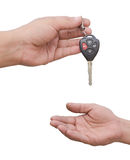 Car key. Male hand holding a car key and handing it over to another person. isolated Stock Photography