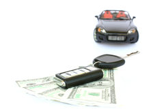A car,key and money. A key with money and black car isolated on a white background Stock Image