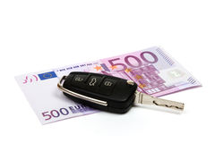Car key, money. Car key on money background Royalty Free Stock Photography