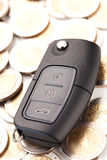 Car key and money - car costs concept Royalty Free Stock Images