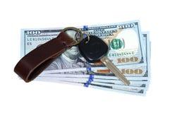 Car key on money isolated on white Royalty Free Stock Photos