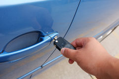 Car key. Nserting Car Key into Vehicle Door Royalty Free Stock Photos