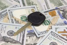 Car key over dollar. Car key located on the hundred dollar banknotes Royalty Free Stock Photography