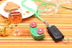 Car key and overturned model vehicle with glass of wine Royalty Free Stock Photo
