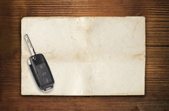 Car key paper and wood Stock Photos