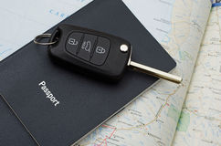 Car key with passport and map Royalty Free Stock Photo