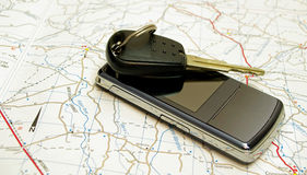 Car key and phone on map Stock Image