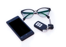 Car key remote, Black Eye Glasses, Smartphone, mobile phone. Isolated on white background Royalty Free Stock Photos
