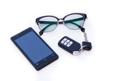 Car key remote, Black Eye Glasses, Smartphone, mobile phone. Isolated on white background Royalty Free Stock Photo