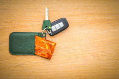 Car key with remote control and credit card. On the wooden table surface stock images