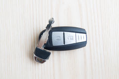 Car key with remote control on the wooden floor Stock Images