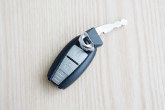 Car key with remote control on the wooden floor Stock Image