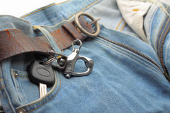 Car key ring and blue jeans Stock Photo