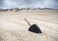 Car key in the sand Stock Photos