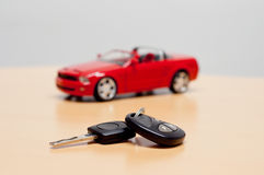 Car key with silhouette of a convertible cabriolet car Stock Image