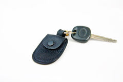Car key and small black leather bag Stock Photo