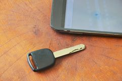 Car key and smart phone opened map on table Royalty Free Stock Photos