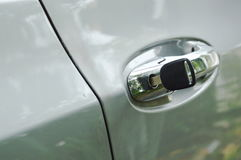 Car key stabbing in handle hole for open door Royalty Free Stock Image