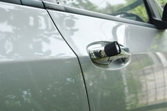 Car key stabbing in handle hole for open door Royalty Free Stock Photography