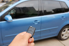 Car key. Is using the remote control key to open the car doors and windows Stock Image