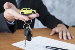 Car key for Vehicle Sales Agreement. Business concept, car insurance, sell and buy car, car financing, car key for Vehicle Sales Agreement Royalty Free Stock Photo