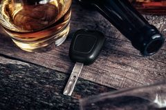 Car key and whisky on bar table. Car key and glass with whisky on bar table Stock Photo