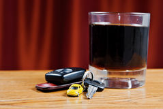 Car key and whisky glass. Concept of drunk driver Royalty Free Stock Images