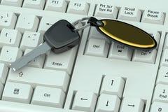 Car key on white computer keyboard Royalty Free Stock Photo