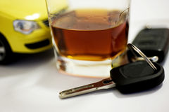 CAR KEY IN A WINE GLASS. Concept of drunk driver Royalty Free Stock Photo