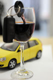 CAR KEY IN A WINE GLASS. Concept of drunk driver Stock Photo