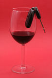 Car key in a wine glass, drunk driver Stock Image