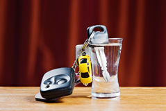 Car key and wodka glass. Concept of drunk driver Royalty Free Stock Images