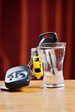 Car key and wodka glass. Concept of drunk driver Royalty Free Stock Photo