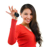 Car key. Young woman holding her first own car key isolated on white background. Beautiful mixed race Caucasian Southeast Asian woman model Royalty Free Stock Photography